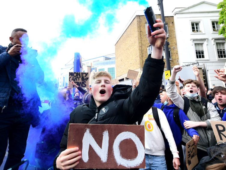 Chelsea fans outside Stamford Bridge protest against the club's involvement in the proposed European Super League (Ian West/PA)