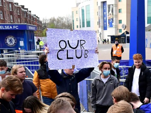 Fans protest against Chelsea's involvement in the new European Super League outside Stamford Bridge (Ian West/PA Images).