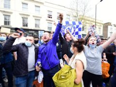 Chelsea fans stage an anti-Super League protest outside Stamford Bridge (Ian West/PA)