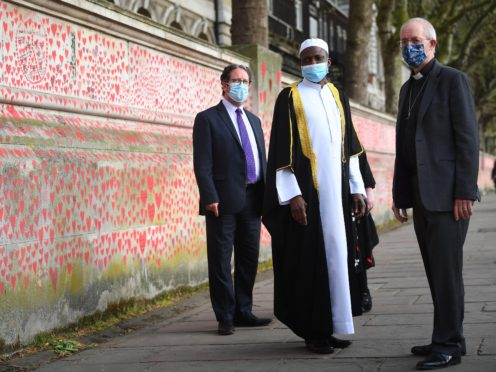 (l to r) Rabbi Daniel Epstein, Imam Kazeem Fatai and The Archbishop of Canterbury Justin Welby visit the wall (Victoria Jones/PA)