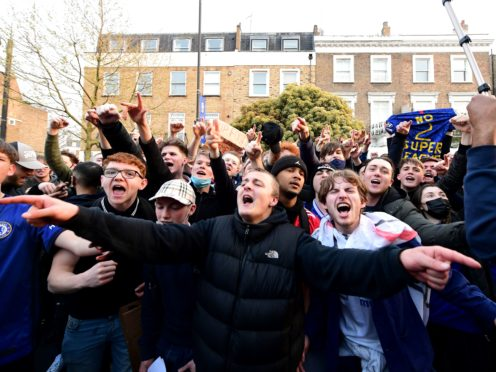 Fans celebrated outside Stamford Bridge (Ian West/PA)