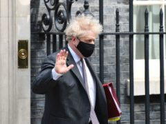Boris Johnson leaves 10 Downing Street to attend Prime Minister's Questions. (Stefan Rousseau/PA)