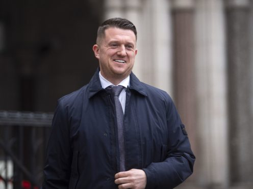 Tommy Robinson leaving the Royal Courts of Justice (Victoria Jones/PA)