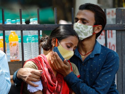Relatives of a Covid-19 victim outside the Lok Nayak Jaiprakash Narayan Covid-19 hospital in New Delhi, India (AP)
