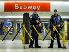 Police stand guard inside the Port Authority Bus Terminal following an explosion near Times Square in New York in 2017 (Andres Kudacki/AP)
