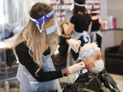 Lorraine Calvert gets her hair done by Laura Stevenson at Natural Hair Company, Lisburn (Peter Morrison/PA)