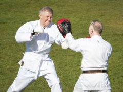 Willie Rennie took shots of a different kind during a karate lesson on the campaign trail (Jane Barlow/PA)
