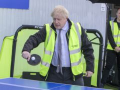 Prime Minister Boris Johnson plays table tennis during a visit to Next World Sports, in Wrexham (Robin Formstone/Daily Telegraph/PA)