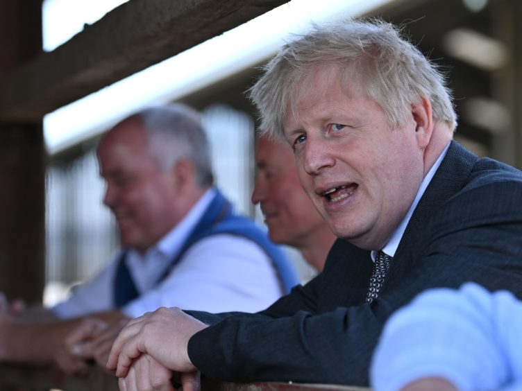 Boris Johnson was earlier accused of saying he would rather see 'bodies pile high in their thousands' (Paul Ellis/PA)
