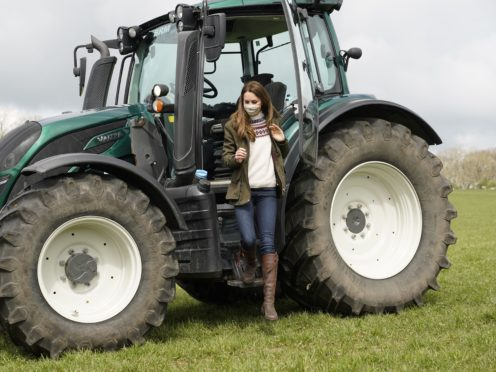 The Duchess of Cambridge steps from a tractor during a visit to Manor Farm in Little Stainton, Durham (Owen Humphreys/PA)