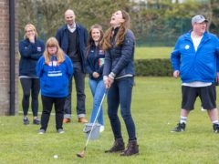 The Duchess of Cambridge laughs as she plays golf during a visit to the Cheesy Waffles Project in Durham (Andy Commins/PA)