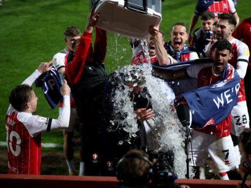 Cheltenham players pour ice over manager Michael Duff (David Davies/PA)