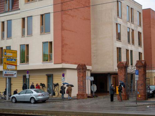 Journalists wait outside the clinic in Potsdam, Germany (Christophe Gateau/AP)