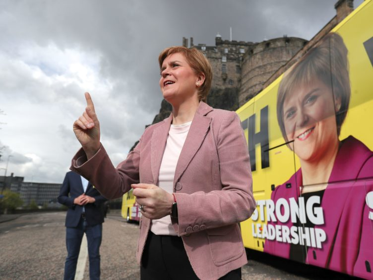 Scottish First Minister and leader of the SNP Nicola Sturgeon speaks in front of Edinburgh Castle (Russell Cheyne/PA)