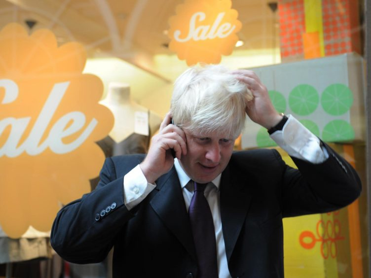 Boris Johnson on the phone while London mayor (Stefan Rousseau/PA)