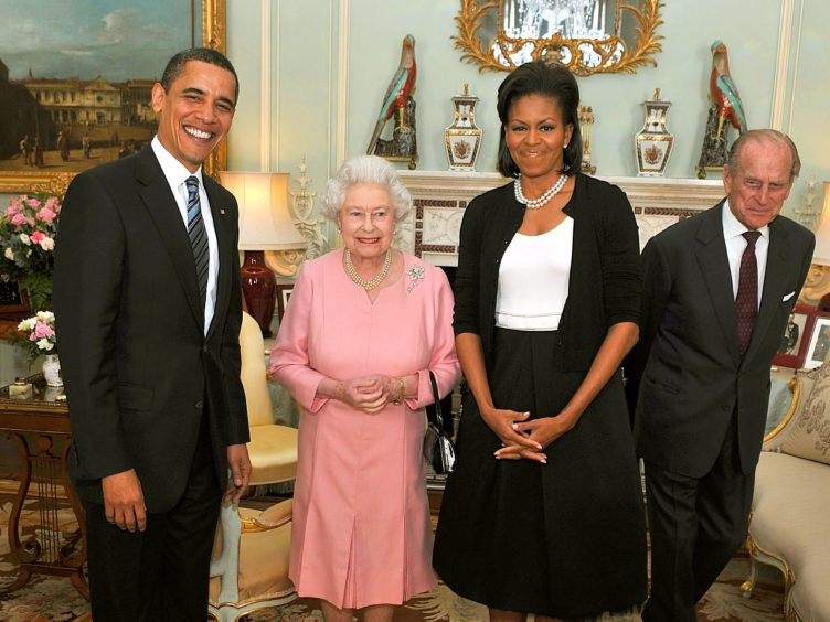 Barack and Michelle Obama with the Queen and the Duke of Edinburgh (JOhn Stillwell/PA)