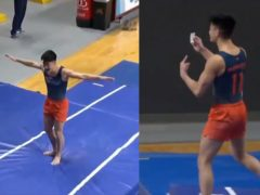Gymnast Evan Manivong celebrates by brandishing his vaccination card (University of Illinois Men's Gymnastics Team)