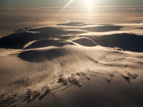 Strong, warm mountain winds blowing snow as they descend slopes of the Antarctic Peninsula above the Larsen C Ice Shelf (Dr Andrew Elvidge/University of East Anglia)