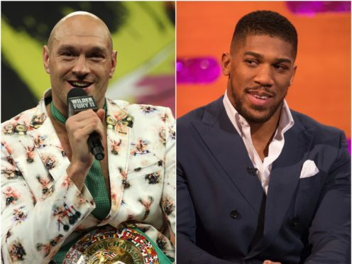 A bout between Anthony Joshua and Tyson Fury seems to be coming closer to being announced (PA)