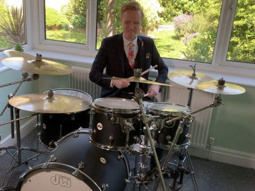 BBC weather presenter Owain Wyn Evans on the drums (BBC)
