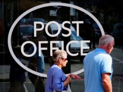 The total amount of cash deposited by people at Post Office branches topped £1bn for the second month in a row in April (Rui Vieira/PA)