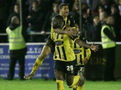 Ayo Obileye, bottom, celebrates scoring for Dagenham & Redbridge (Steve Paston/PA)