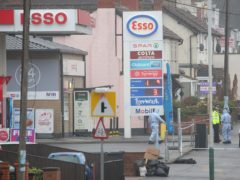 Forensic officers at an Esso petrol station in Collier Row Road, Romford (Isabel Infantes/PA)