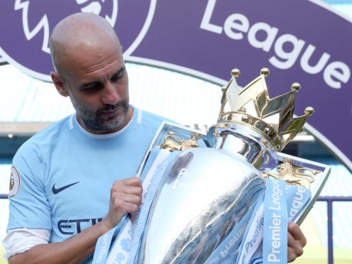 Pep Guardiola has another chance to admire the Premier League trophy (Martin Rickett/PA)