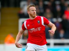 Former Salford striker Adam Rooney came off the bench to head the winning goal (Richard Sellers/PA)