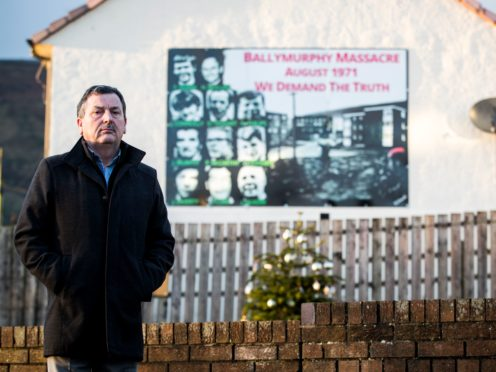 John Teggart, standing in the Ballymurphy area of west Belfast, where his father was among those killed (Liam McBurney/PA)