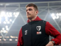 Bournemouth goalkeeper Mark Travers walks the pitch prior to the Premier League match at the London Stadium.