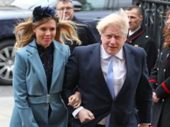 Boris Johnson and his partner Carrie Symonds are to 'celebrate their wedding' in July 2022 (Yui Mok/PA)