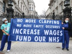 Health staff hold a protest over the proposed 1% pay rise (Jonathan Brady/PA)