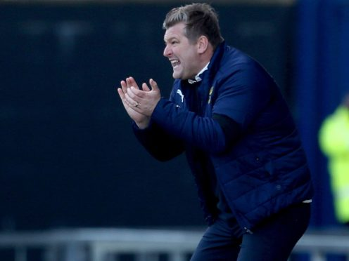 Karl Robinson's side are still in the play-off race (Steven Paston/PA)