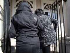 Jennifer Johnson, right, is bundled into Lewes Crown Court (Gareth Fuller/PA)