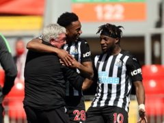 Newcastle head coach Steve Bruce (left) is aiming to at least match last season's Premier League points tally (Clive Brunskill/PA)