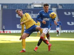 St Johnstone's Jamie McCart, left, during the quarter-final at Ibrox (Andrew Milligan/PA)