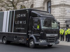 A John Lewis van passing Downing Street (Paul Grover/PA)