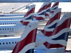 The owner of British Airways has called on the Government to be ambitious with its travel corridor list (Victoria Jones / PA)