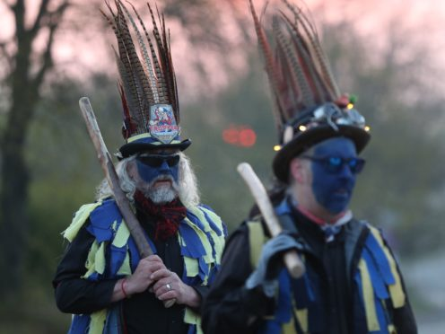 The Hook Eagle Morris Men are wearing blue face paint for the first time (Andrew Matthews/PA)