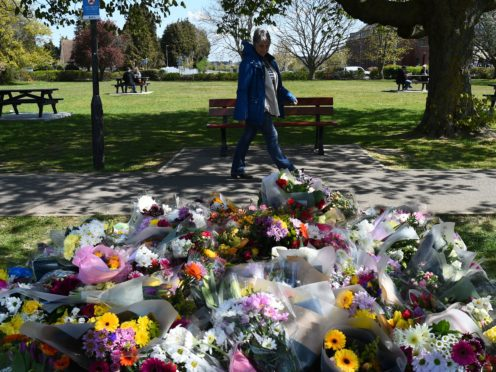 Floral tributes in a park in Aylesham village close to the scene in Snowdown, Kent, where the body of PCSO Julia James was found (Kirsty O'Connor/PA)