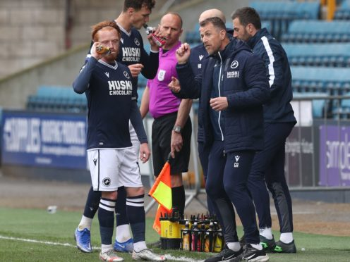 Gary Rowett, right, speaks to his team in front of an empty stand (Jonathan Brady/PA)