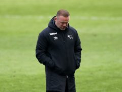 Derby boss Wayne Rooney appears dejected at the end of the match at Swansea (Nick Potts/PA)