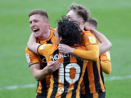 Hull players celebrate being crowned champions (Richard Sellers/PA)