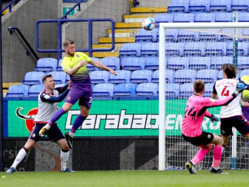 Exeter defender Pierce Sweeney (left) scores his side's winning goal at Bolton (Tim Markland/PA)