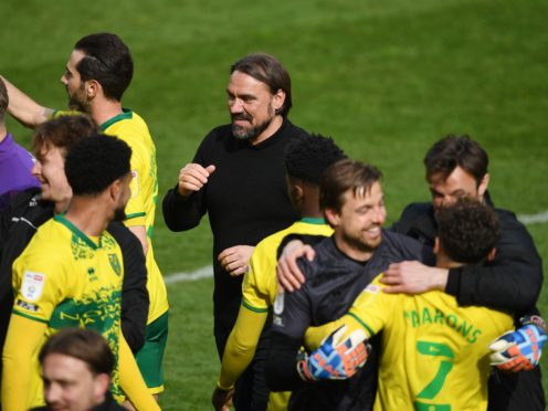 Daniel Farke celebrates with his players after Norwich were crowned champions (Joe Giddens/PA)