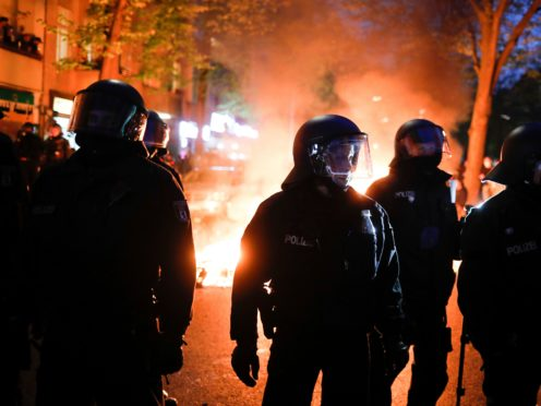 Police officers during a May Day rally in Berlin (Markus Schreiber/AP)