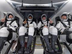 Nasa astronauts Shannon Walker, Victor Glover and Mike Hopkins, and Japan Aerospace Exploration Agency astronaut Soichi Noguchi (Nasa via AP)