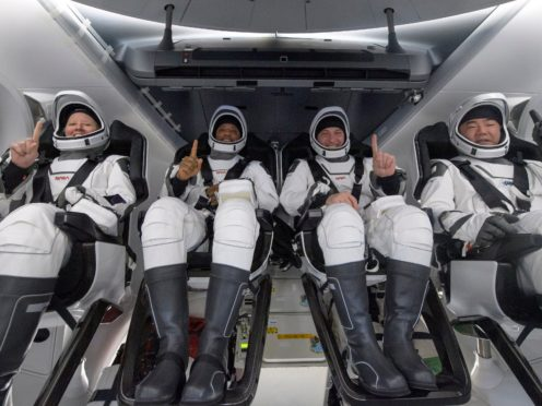 Nasa astronauts Shannon Walker, Victor Glover and Mike Hopkins, and Japan Aerospace Exploration Agency astronaut Soichi Noguchi (Nasa via AP)