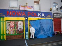 Forensic officers enter a shop on Waterloo Road, Smethwick (PA)